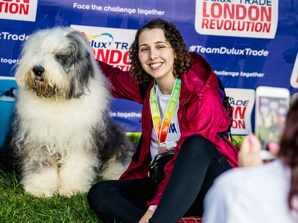 Dulux dog with a smiling girl