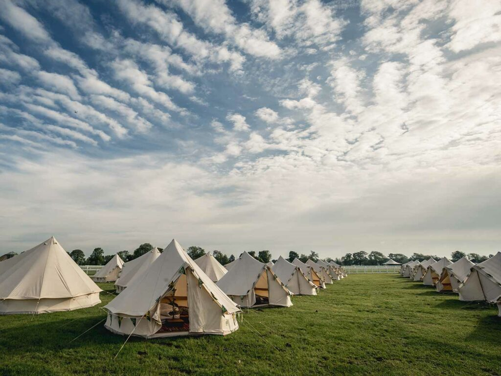 Glamping tents in sunny skies