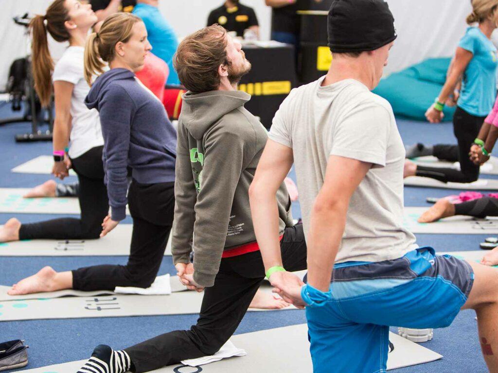 people doing yoga together